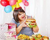 image of bag-of-dog-food  - Woman eating hamburger at birthday - JPG