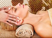 stock photo of beauty parlour  - Woman getting facial massage in tropical beauty spa - JPG