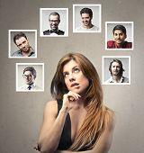 beautiful woman undecided about which man to choose