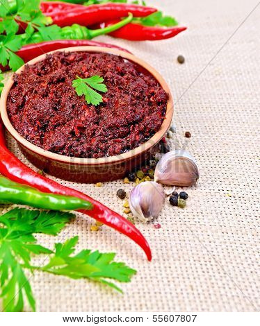 Adjika With Hot Pepper And Garlic On Burlap