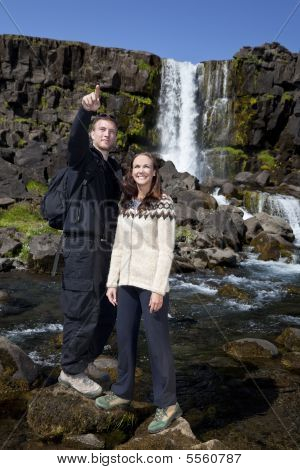 Romantic Couple By A Waterfall