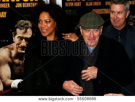"""NEW YORK-DEC 16: Model Grace Hightower and Robert DeNiro (R) attend the world premiere of """"Grudge Match"""" at the Ziegfeld Theatre on December 16, 2013 in New York City."""