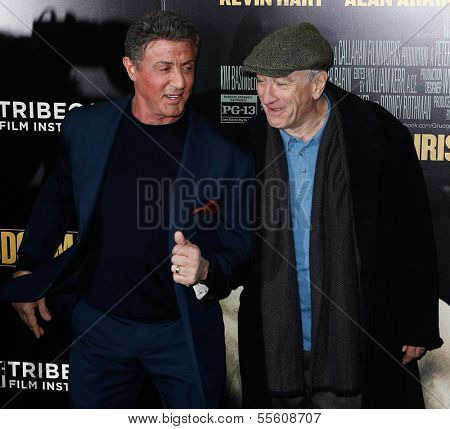 "NEW YORK-DEC 16: Actor Robert DeNiro (R) and Sylvester Stallone attend the world premiere of ""Grudge Match"" at the Ziegfeld Theatre on December 16, 2013 in New York City."
