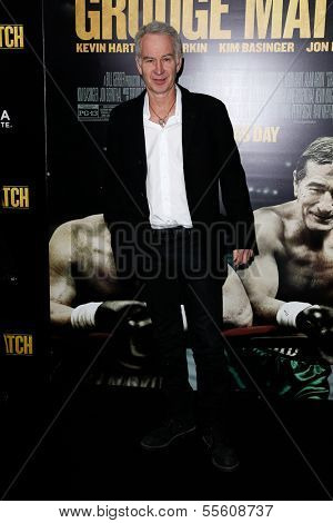 "NEW YORK-DEC 16: Tennis announcer John McEnroe attends the world premiere of ""Grudge Match"" at the Ziegfeld Theatre on December 16, 2013 in New York City."