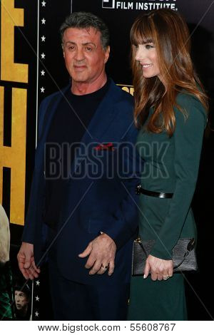 "NEW YORK-DEC 16: Actor Sylvester Stallone and wife Jennifer Flavin attend the world premiere of ""Grudge Match"" at the Ziegfeld Theatre on December 16, 2013 in New York City."