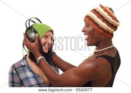 Smiling Young Couple With Big Headphones