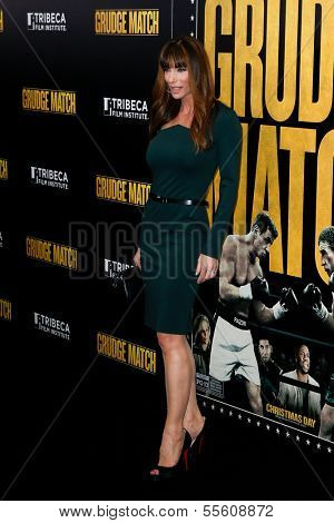 "NEW YORK-DEC 16: Model Jennifer Flavin attends the world premiere of ""Grudge Match"" at the Ziegfeld Theatre on December 16, 2013 in New York City."