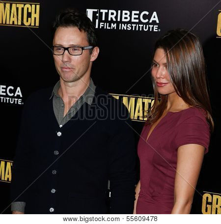 """NEW YORK-DEC 16: Actor Jeffrey Donovan and wife Michelle Woods attend the world premiere of """"Grudge Match"""" at the Ziegfeld Theatre on December 16, 2013 in New York City."""
