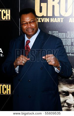 """NEW YORK-DEC 16: Boxer Larry Holmes attends the world premiere of """"Grudge Match"""" at the Ziegfeld Theatre on December 16, 2013 in New York City."""