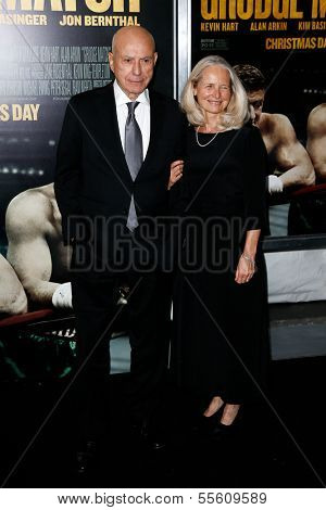 """NEW YORK-DEC 16: Actor Alan Arkin and wife Suzanne Newlander attend the world premiere of """"Grudge Match"""" at the Ziegfeld Theatre on December 16, 2013 in New York City."""