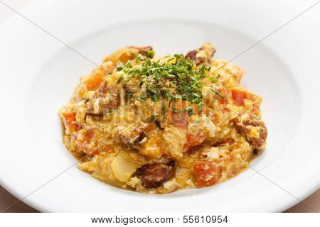 meal called leco (mixture of vegetables and eggs with sausage)