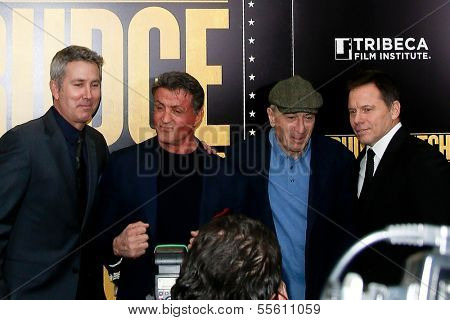 """NEW YORK-DEC 16: Actor Robert DeNiro (R) and Sylvester Stallone attend the world premiere of """"Grudge Match"""" at the Ziegfeld Theatre on December 16, 2013 in New York City."""