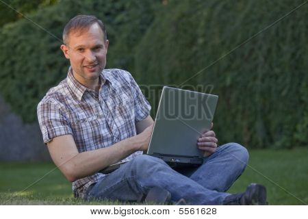 Man With Computer Outdoor