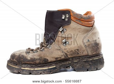 Old Trekking Boot In Mud. Side View.