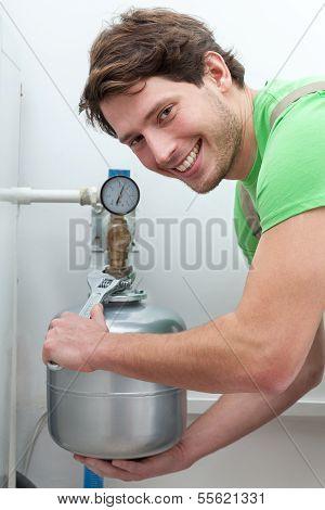 Happy Man Repairing Boiler