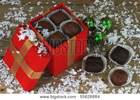 Christmas Chocolate Candies In Winter Snow