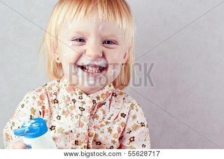 Happy  Little Girl  With Body Cream