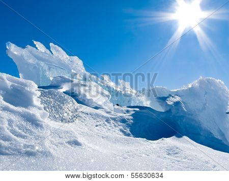 Glacier Ice Chunks With Snow And Sunny Blue Sky