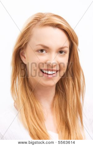 Smiling Friendly Young Blond Woman Showing Teeth