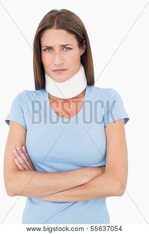 Portrait of a young woman wearing cervical collar over white background