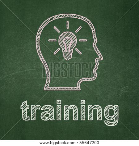 Education concept: Head With Lightbulb and Training on chalkboard background