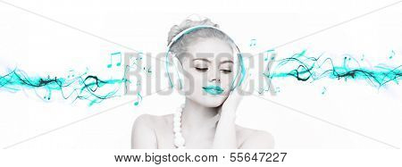 Beautiful woman enjoying her music listening to her headphones with a smile of bliss, artistic toned portrait with selective turquoise colour and streaming music