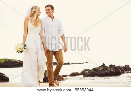 Bride and Groom, Romantic Newly Married Couple Holding Hands Walking on the Beach, Just Married