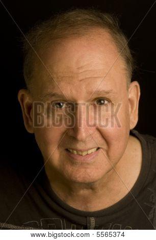 Senior Man Retired Head Shot Portrait In Tee Shirt