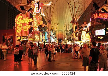LAS VEGAS, US - OCTOBER 13: Ambiance in Fremont Street at night on 13, 2011 in Las Vegas. There are the older casinos and most of the icons of the city, such as the cowgirl neon sign of Glitter Gulch