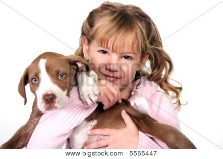 Adorable Little Girl Holding Her Puppy