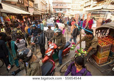 KATHMANDU, NEPAL - DEC 1: Traffic jam in one of a busy street in the city center, Dec 1, 2013 in Kathmandu, Nepal. With an area of ??50.67 km in Kathmandu city is home to more than 1 million people.