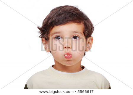 Little Cute Kid Eating With Filled Mouth