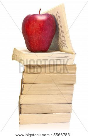 Stack Of Books With Red Apple Isolated On White