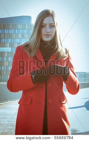 Beautiful Girl Posing With Red Coat