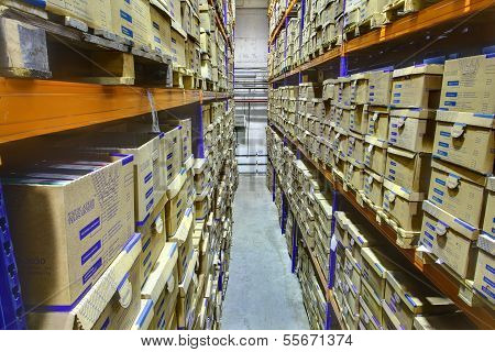 Shelf Racks With Boxes In Storage Warehouse, The Interior Space.