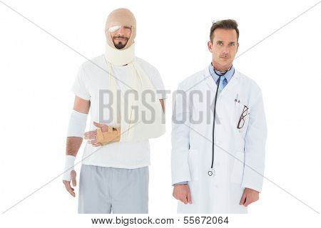 Portrait of a doctor with patient tied up in bandage over  white background
