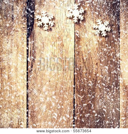 Vintage Christmas Card With White Snowflakes And Falling Snow. Christmas Decoration Over Wooden Back