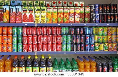 Bottles Of Soft Drinks On A Market Shelves