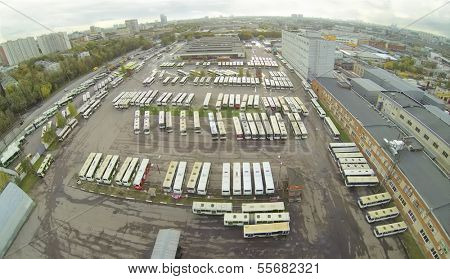 Top view of large bus parking. View from unmanned quadrocopter.
