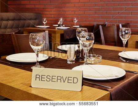 Closeup served table with sign Reserved in cafe