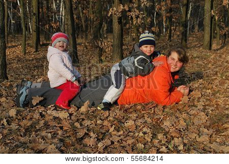 Family Dabbles In The Autumn Forest