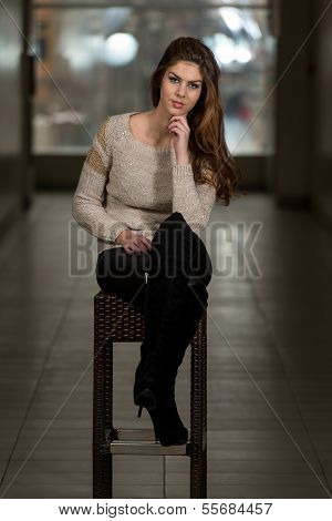 Beautiful Young Brown Model Sitting On The Chair