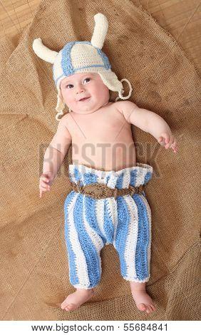 Little viking in homemade knitted costume.