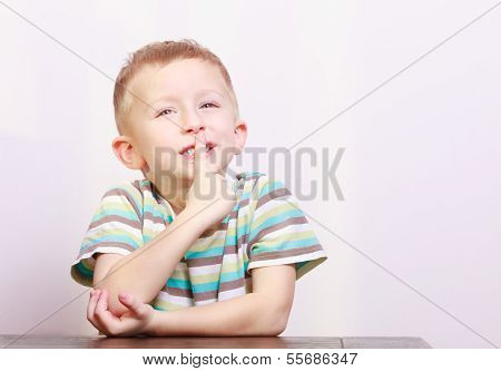 Portrait Of Pensive Thoughtful Blond Boy Child Kid At The Table