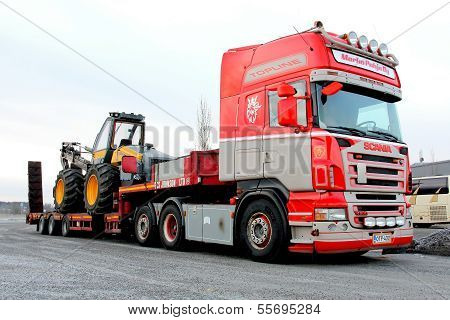 Scania R500 Truck Hauling a Forest Harvester