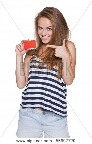 Excited girl teenager hipster pointing to the blank credit card