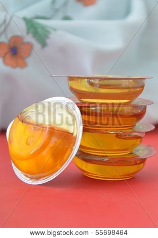 sweet honey in small plastic containers
