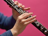 stock photo of clarinet  - The hands of a musician playing on a clarinet - JPG
