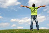 stock photo of open arms  - man with his arms wide open - JPG