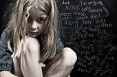 stock photo of abused  - Child abuse little frightened girl neglected by parents - JPG